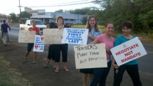 Teachers protest in front of Kaunakakai School last week. Photo by Jenn Whitted