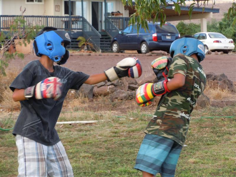 Two young Molokai boxers spar during practice at the home of their coach, Tomasito Manangan. Photo by Catherine Cluett