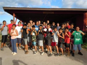 Members of Molokai Southside, TNT Molokai and Morroc's boxing clubs stand together as they prepare for the Molokai Southside Boxing Invitational this Saturday at the Barn. Photo by Catherine Cluett