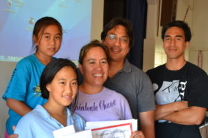 Sixth grader Maile Sasada won first place at the Kualapu`u School Tech Show. She is pictured here with her family. Photo by Catherine Aki
