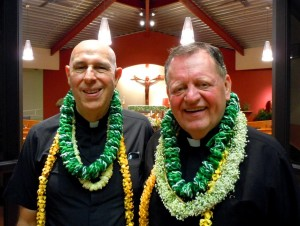 Bishop Larry Silva and Father William Petrie (right) at his installation at St. Damien Church. Photo by Catherine Cluett