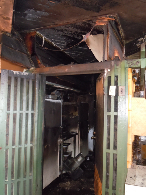The door to the now-charred kitchen of Hotel Molokai. Photo by Catherine Cluett