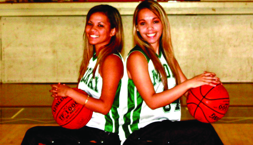 Seniors Brianna Tangonan and Kalyn Kaulia-Makaiwi pose for pictures on their home court.