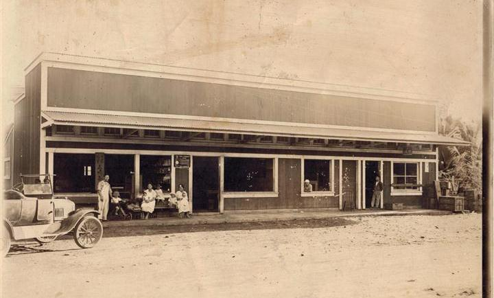 The original Misaki's shop, across the street from the present-day store. Masataro Misaki standing on the left, Uta seated, with three of their children and family friends on the right. Photo courtesy Irene Iwane.