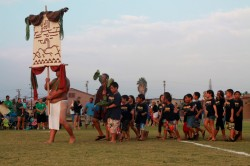 Makahiki competitors enter the game arena with their ho`okupu to Lono.