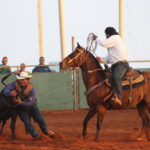 Cowboys compete in double mugging. Photo by Colleen Uechi.