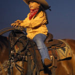 Five-year-old cowgirl Helena Dudoit. Photo by Colleen Uechi.