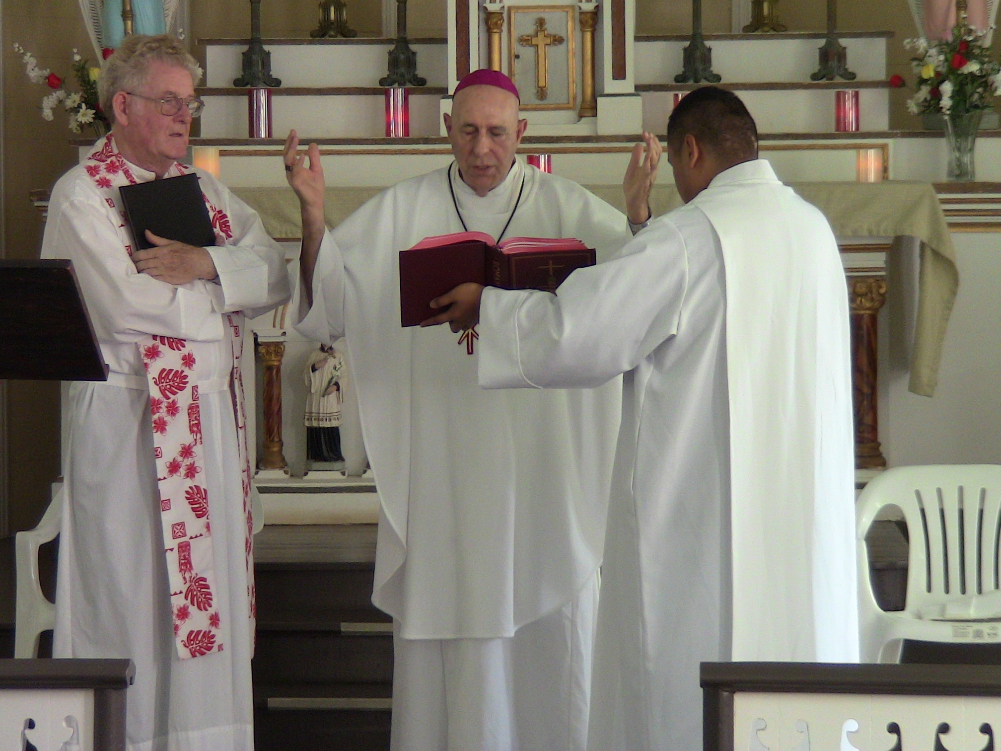 Father Patrick Killilea (left) was installed on July 11 as the new pastor of Kalaupapa's St. Francis Church by Honolulu Bishop Larry Silva (center). Photo by Mark Miller.
