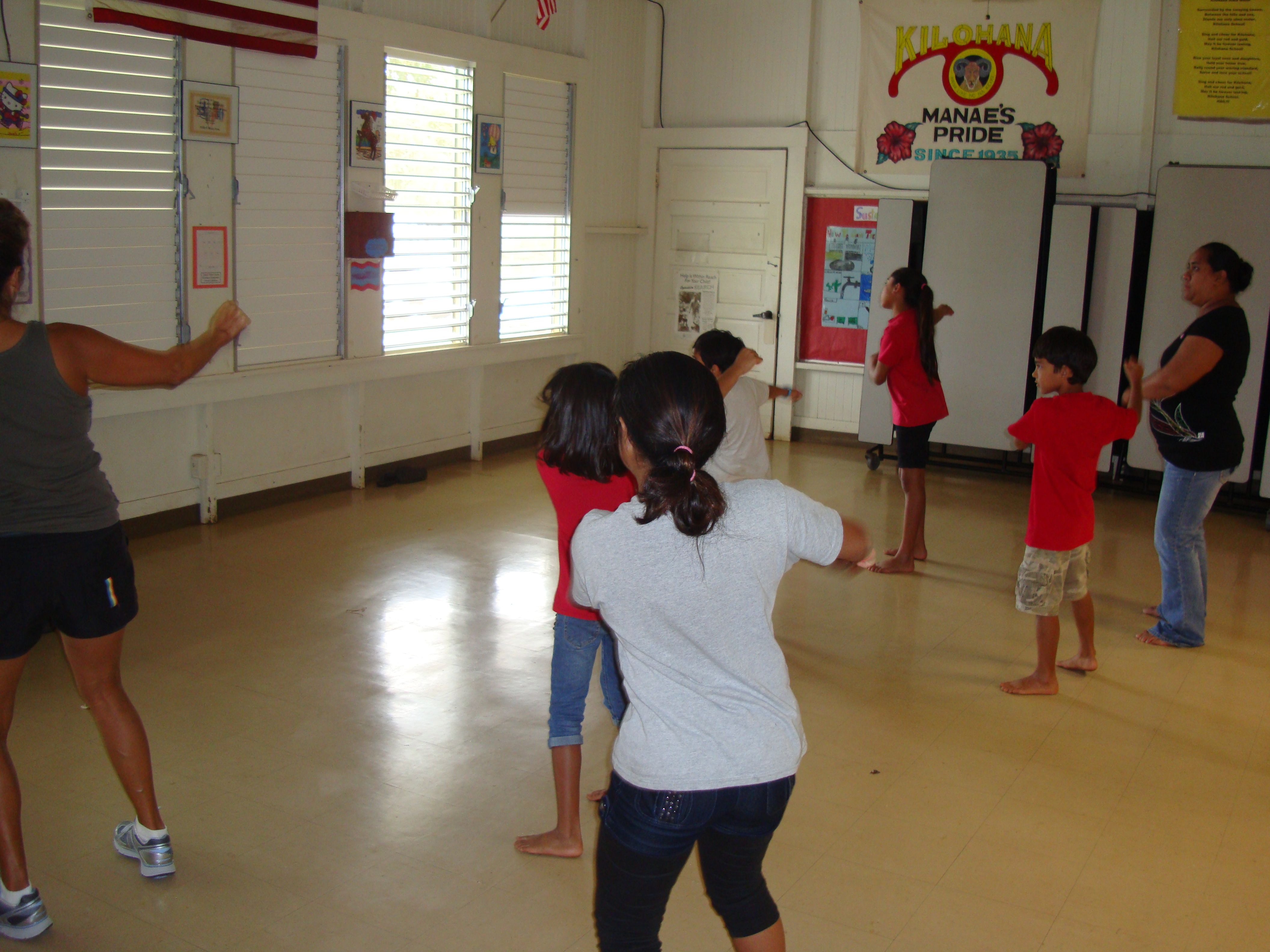 The Kilohana Dancercise class follows along as their instructor Lani Sawyer (on left) gets them moving to the beat.