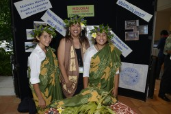 Molokai Middle School's Kaeya Cummings (left), Meleana Pu Kala (right), and their mentor Iolani Kuoha