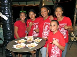 Qwynci, Kamaka, Kaulupa and Skylar help hotel staff with service