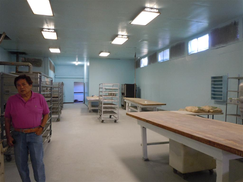Owner George Kanemitsu stands in the newly-cleaned bakery facility. Photo by Catherine Cluett