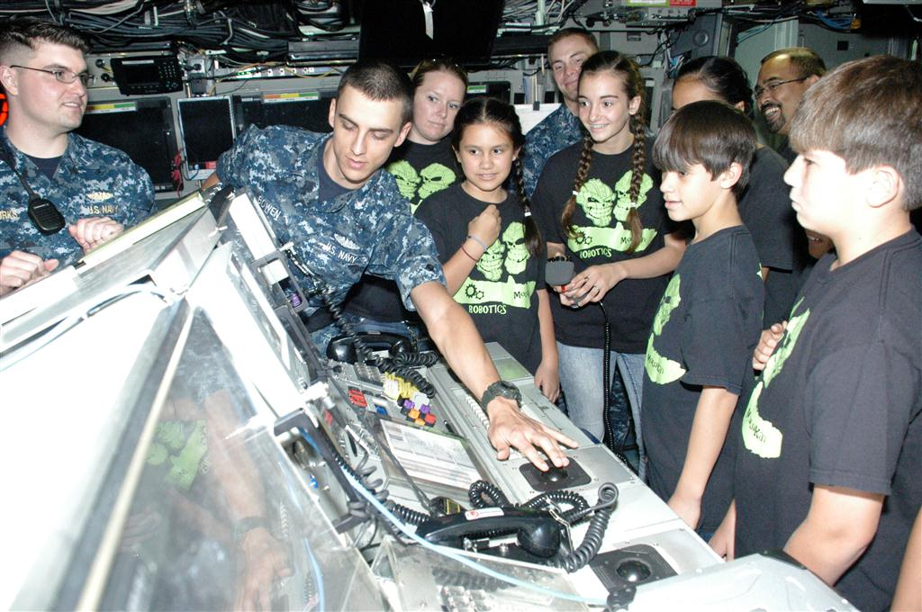 Sailors from USS Hawaii show the students the periscope view screen during a tour of the submarine. Photo by David Tomiyama.