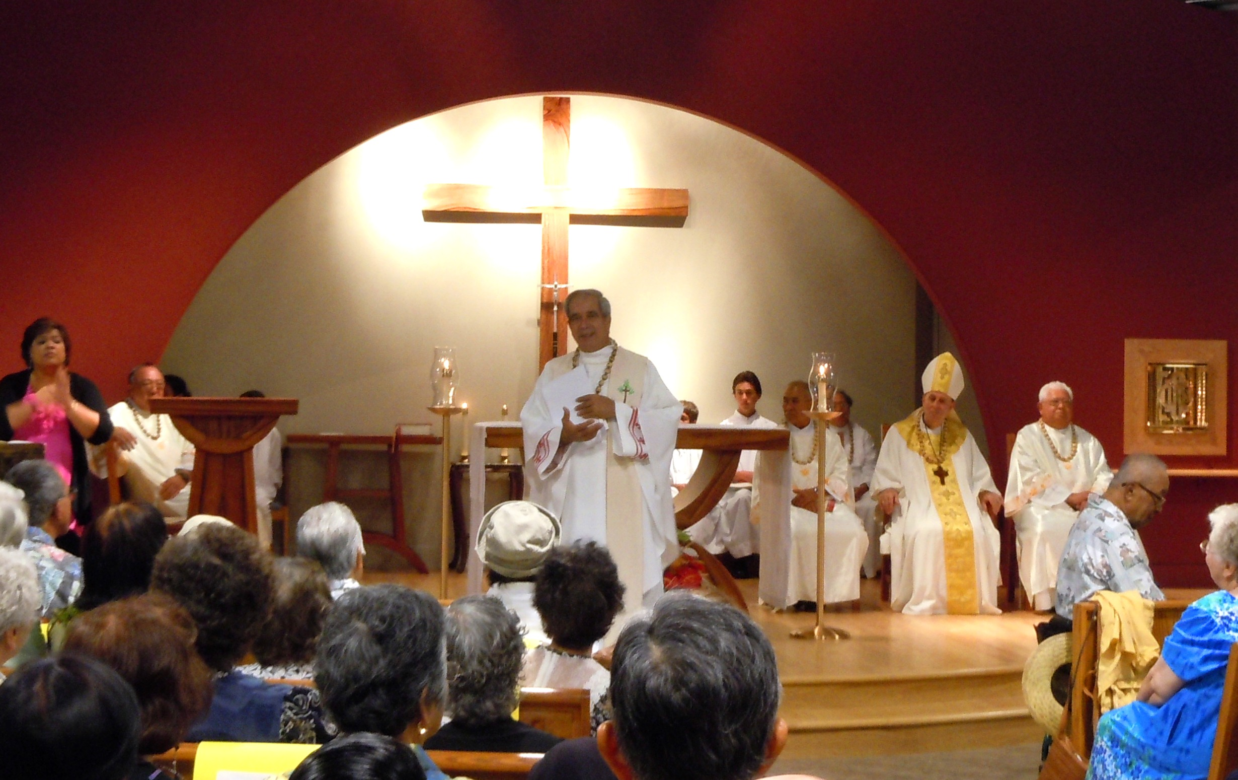 Father Clyde during the dedication Mass of the new St. Damien Church last year. Photo by Catherine Cluett