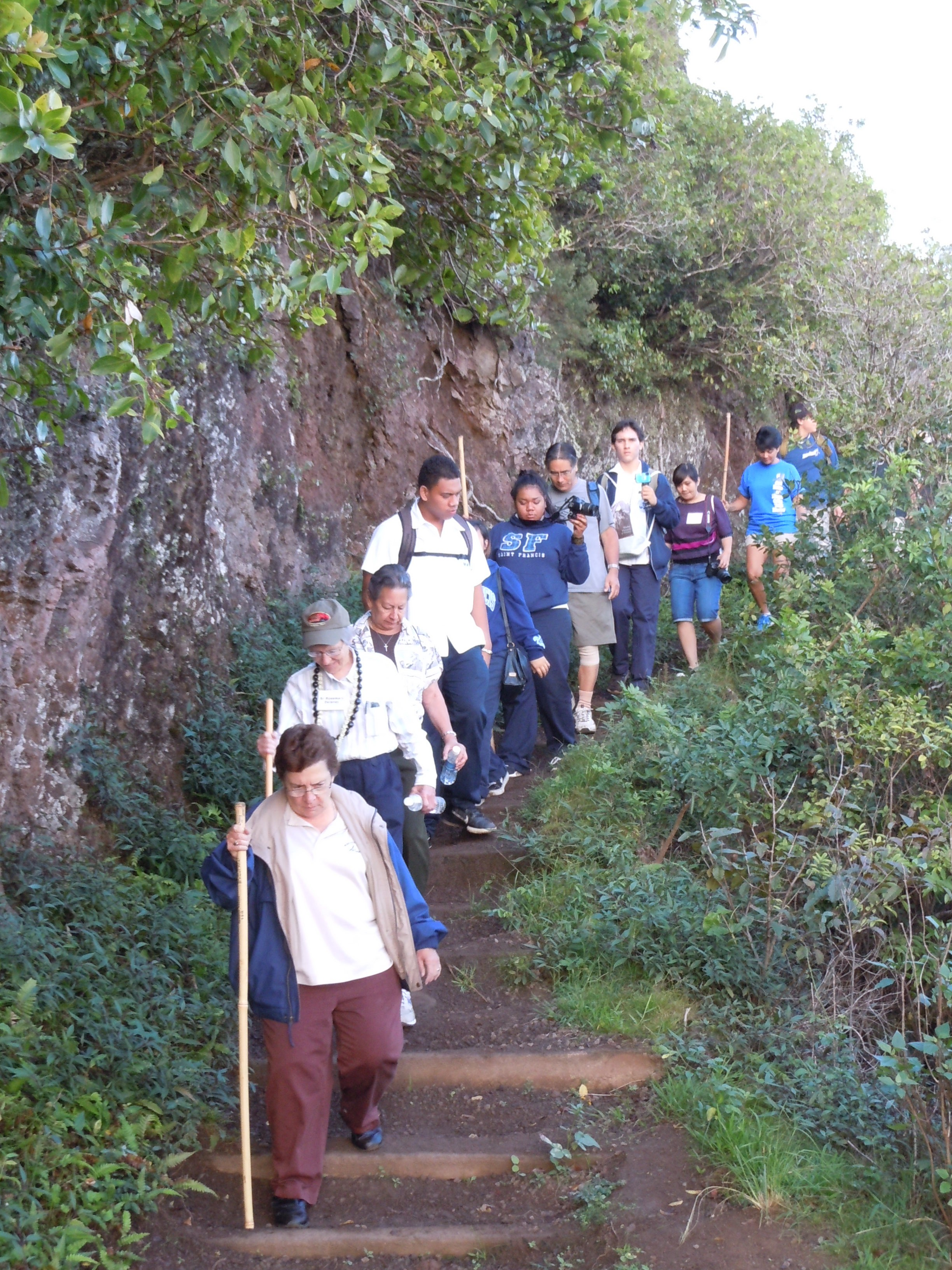 A group of Franciscan sisters, students from St. Francis High School on Oahu, and a few Molokai residents hiked with the relic down to Kalaupapa. Photo by Catherine Cluett