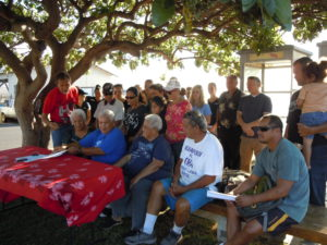 Community members, American Safari Cruises staff, state officials and protesters gathered last Wednesday in a spirit of understanding to sign an agreement that concludes more than a year of conflicts. Photo by Catherine Cluett