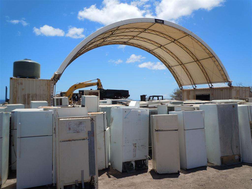 Fridges awaiting processing at the Molokai Metals Recycling Facility at the landfill. Photo by Catherine Cluett
